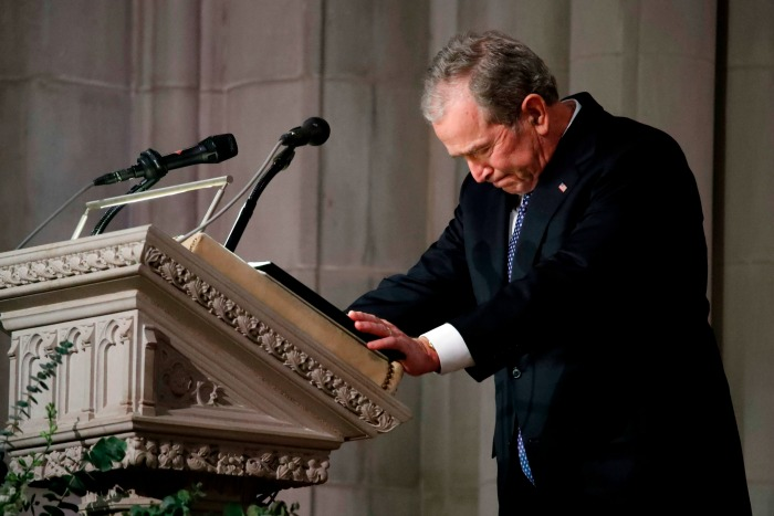 George W Bush fought back tears as he ended his eulogy. Source: Getty.