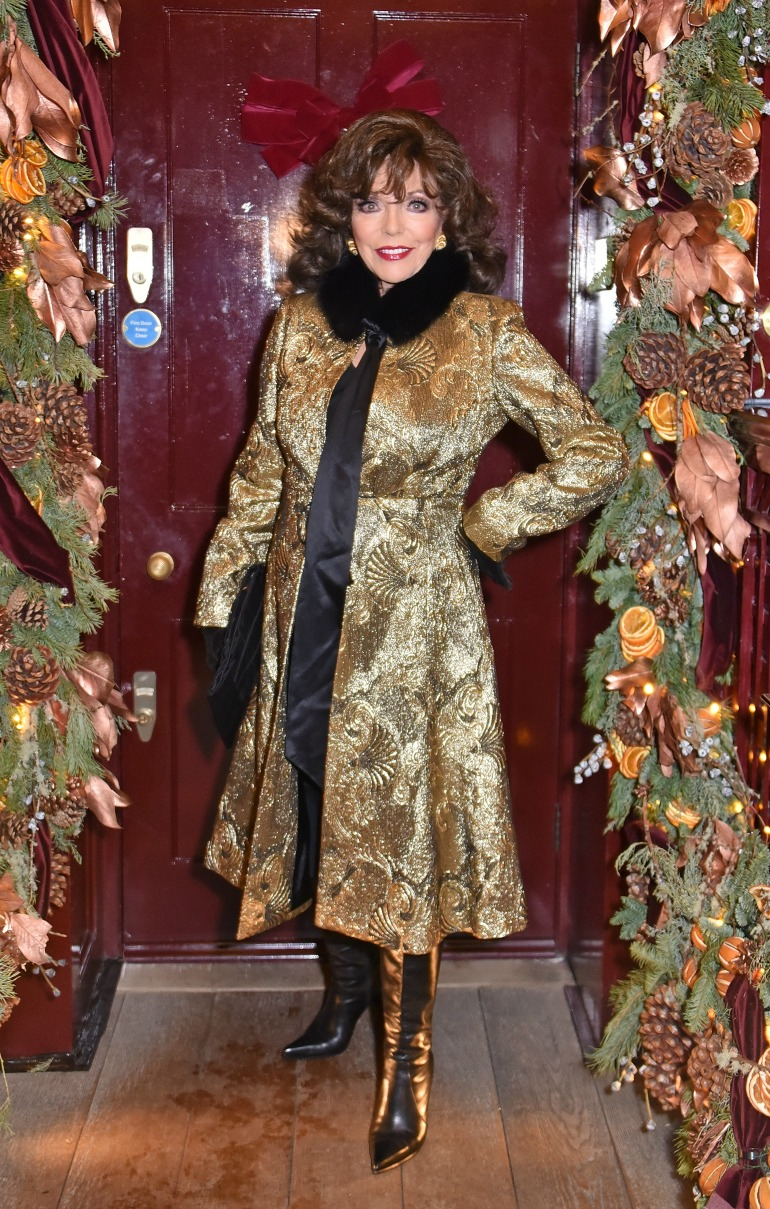 Joan Collins was pictured looking fabulous as she stepped out in a dazzling gold coat in London on Wednesday night. Source: Getty