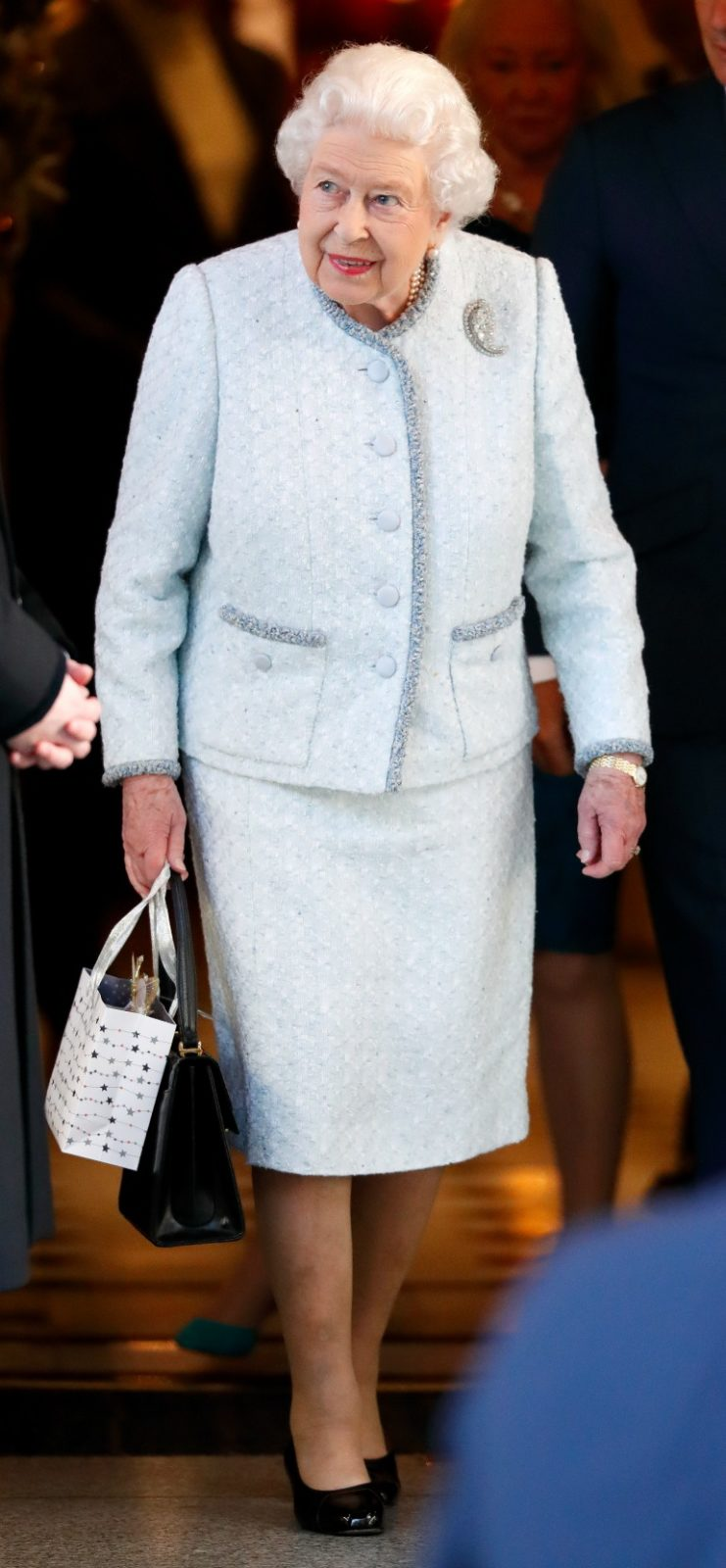 Queen Elizabeth stepped out in a gorgeous winter ensemble to attend a Christmas lunch on Tuesday. Source: Getty