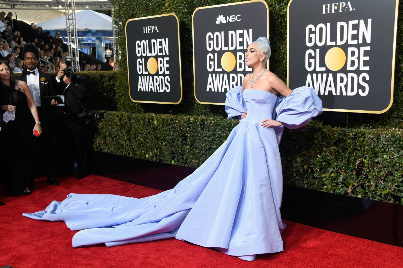 Lady Gaga dazzled in a strapless gown by Valentino. Source: Getty