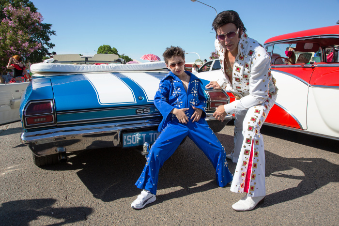 Elvis fans dress up for the street parade at the event in Parkes.