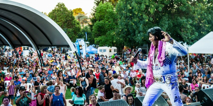 An Elvis fan takes to the stage at the Parkes Elvis Festival.