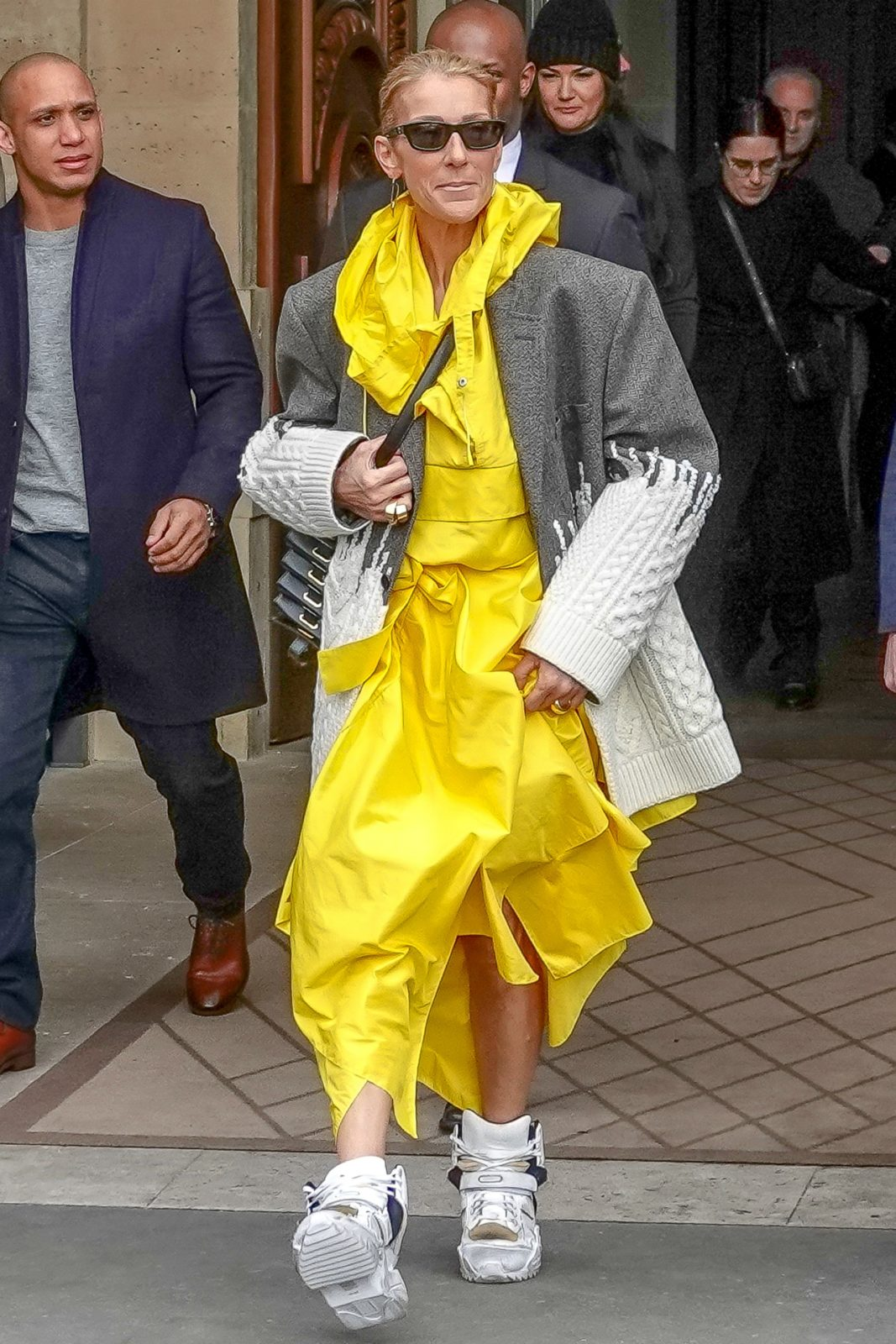 Celine Dion was spotted in Paris sporting an eye-popping yellow ensemble.