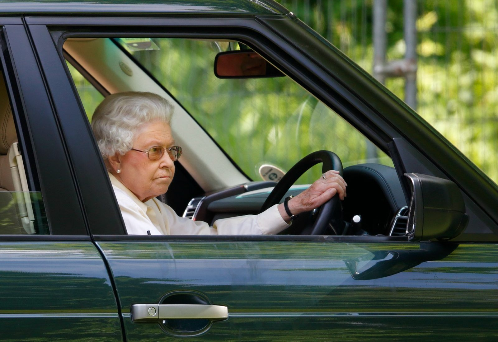 The Queen is often spotted driving herself around. Source: Getty.