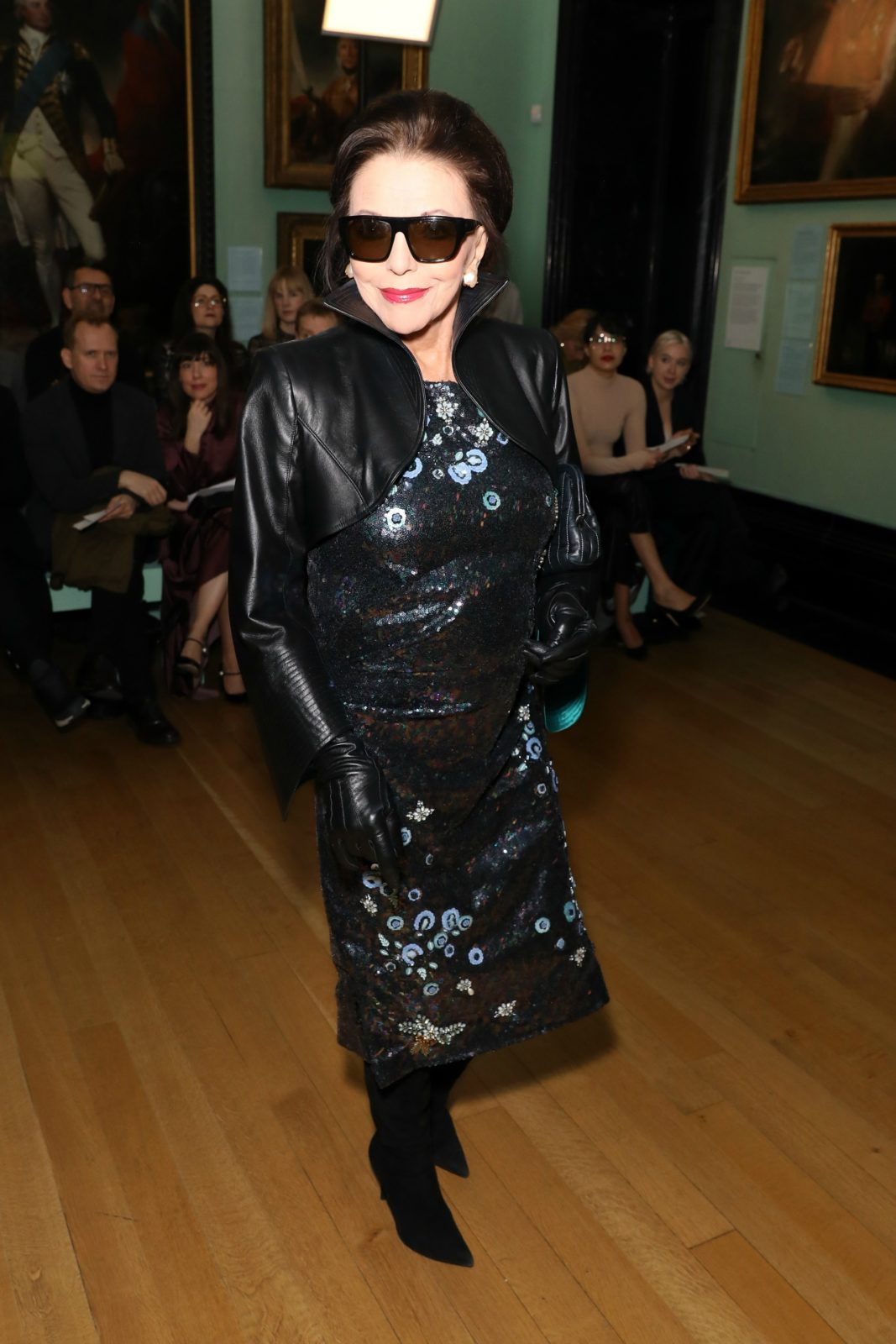 Joan Collins dazzled in a sequinned dress and cropped leather jacket as she attended a fashion event in London on Monday. Source: Getty