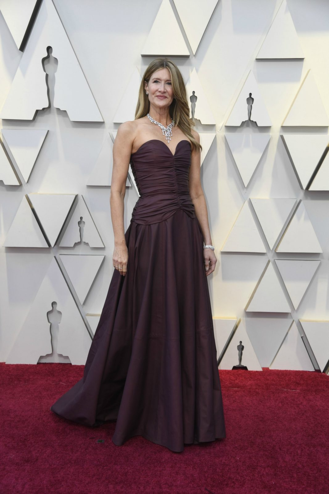 Laura Dern commanded attention in a burgundy strapless gown. Source: Getty
