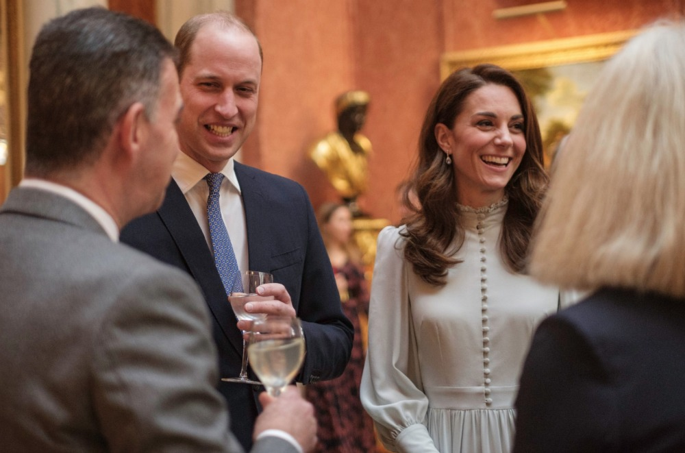 William and Catherine shared a laugh with guests at event honouring the Prince of Wales. Source: Getty