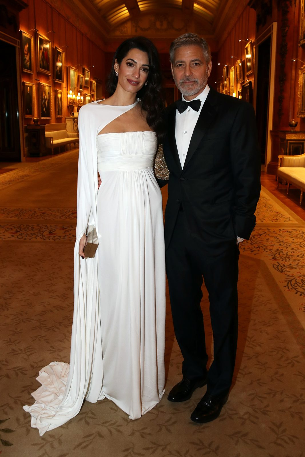 Amal and George Clooney stepped out for a dinner at Buckingham Palace on Tuesday. Source: Getty