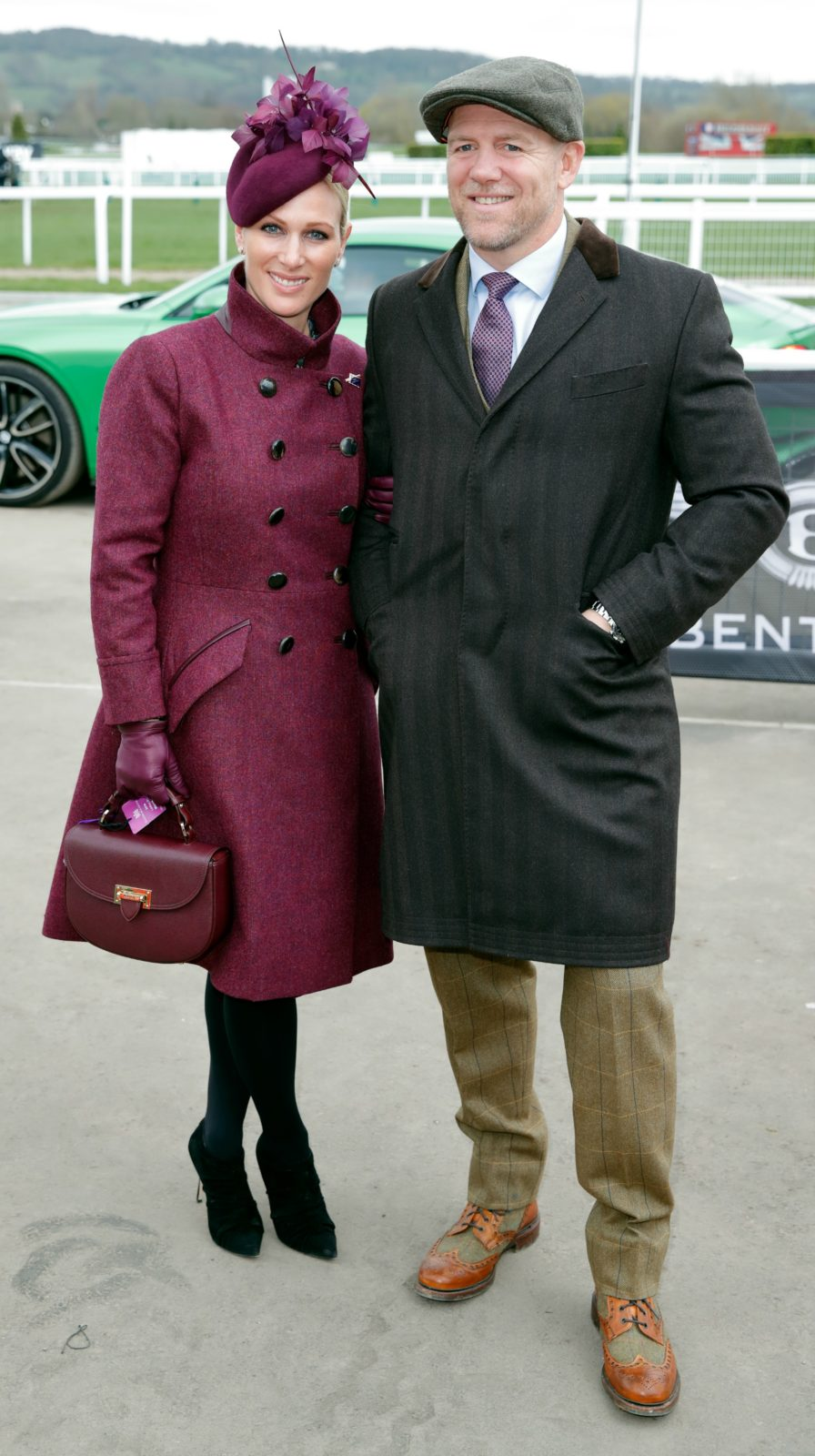 Zara opted for a deep purple outfit when she attended the races alongside Mike.
