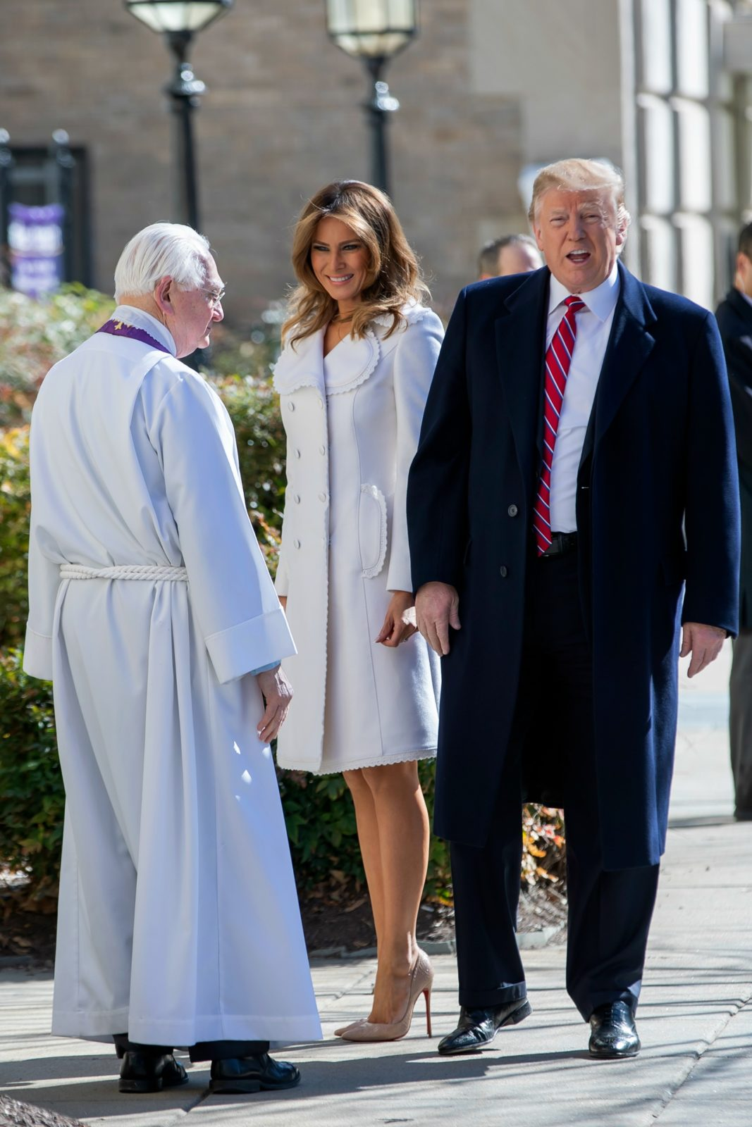 Melania Trump looked stunning in a white coat as she attended a St Patrick's Day church service alongside husband Donald Trump. Source: Getty