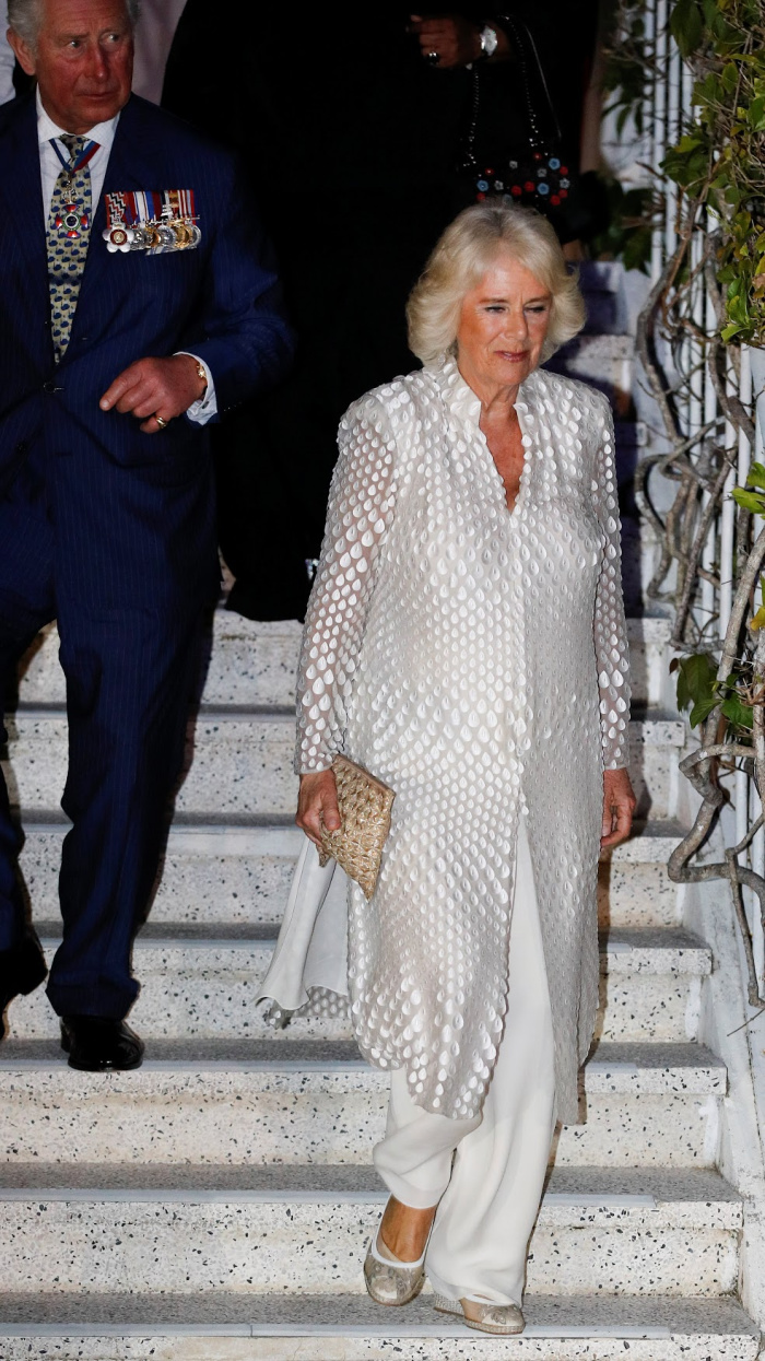 Camilla looked gorgeous in white as she arrived for a reception at the Prime Minister's residence during a Caribbean tour.