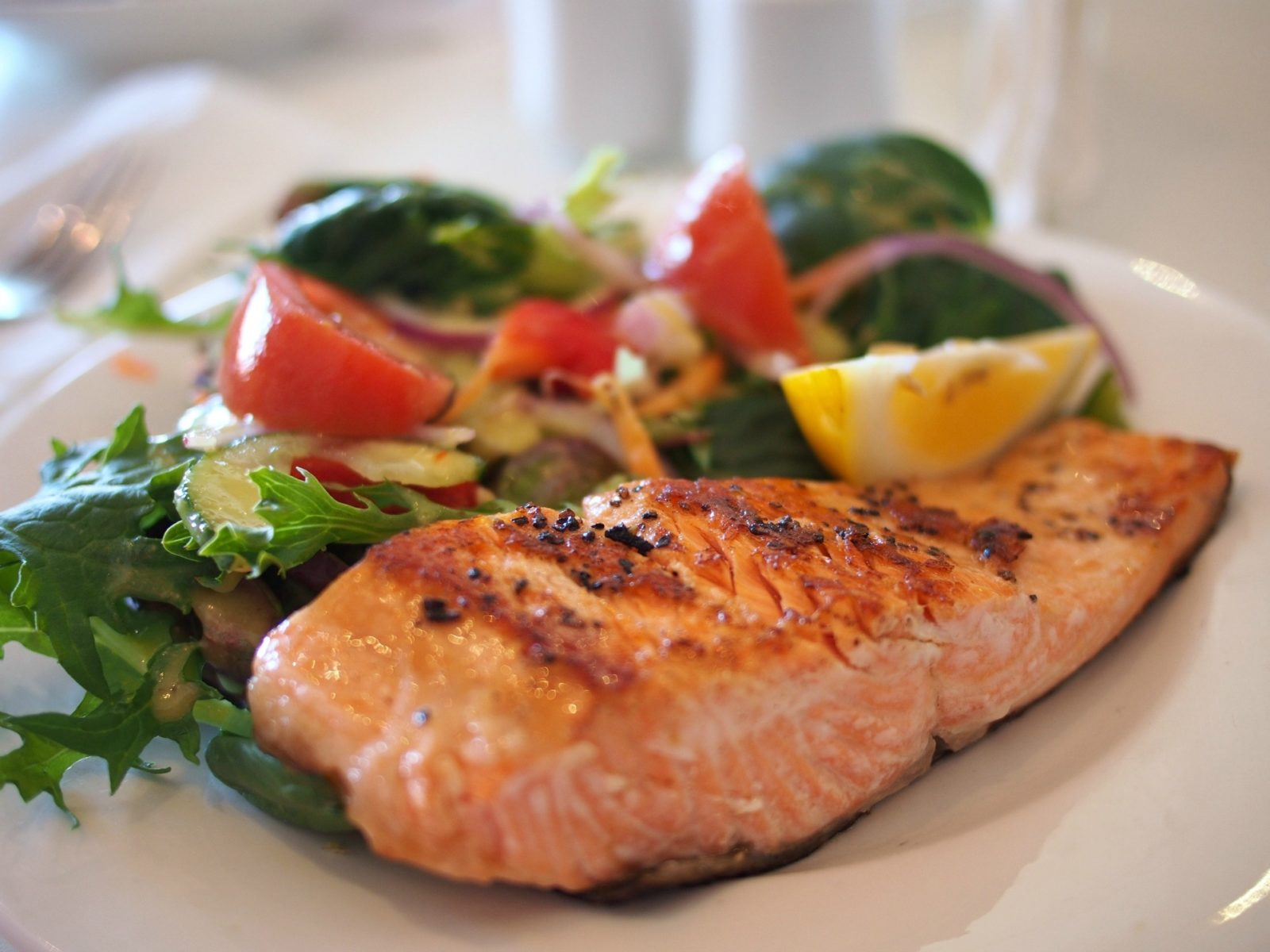 Foods such as salmon are are rich in omega 3 acid and fatty acids, which may reduce pain and inflammation.