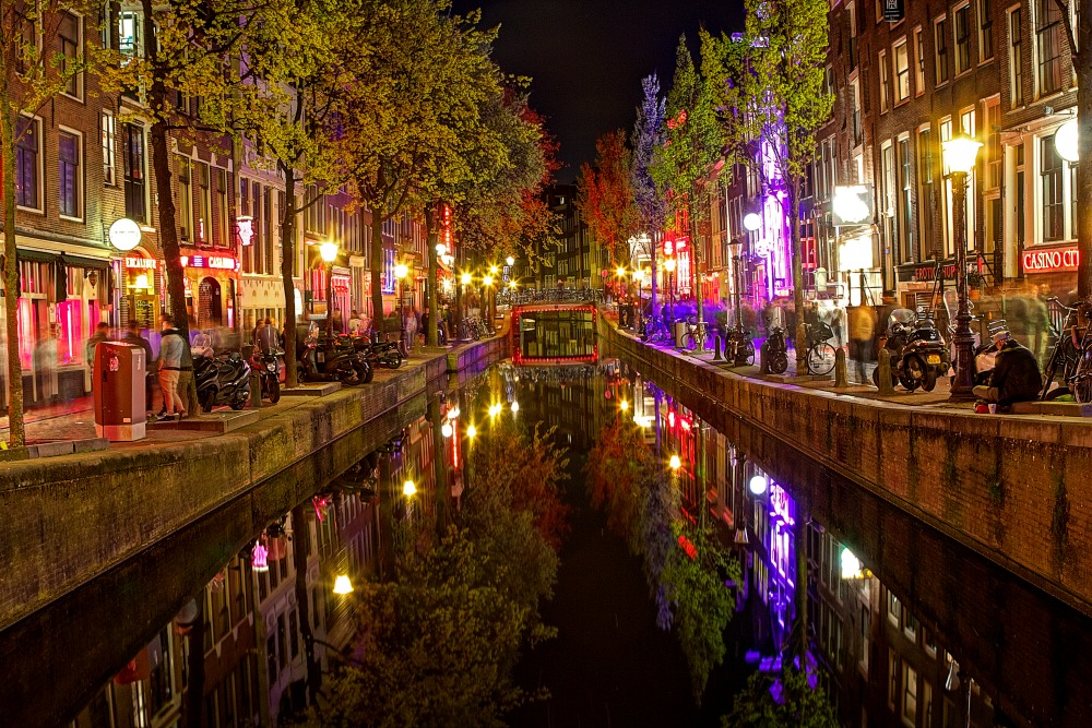 The red light district is known for its brothels, sex shops and numerous prostitutes standing in red-lit windows. Source: Getty