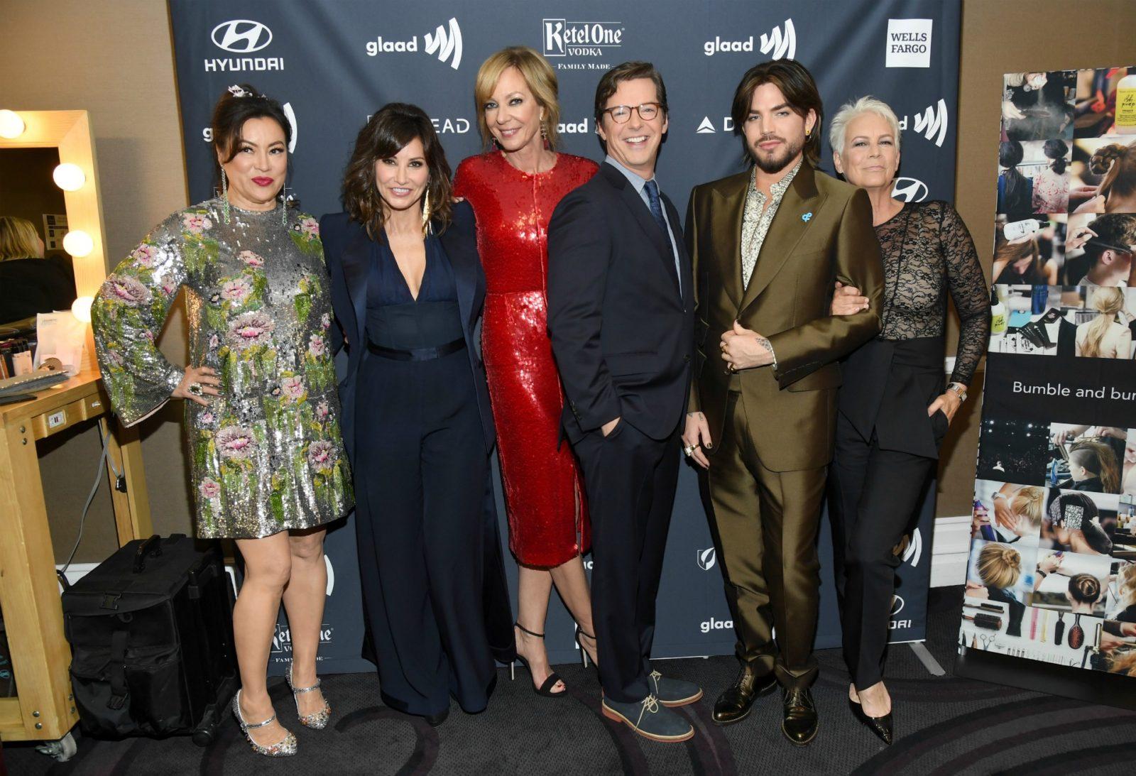 Jennifer Tilly, Gina Gershon, Allison Janney, Sean Hayes, Adam Lambert, and Jamie Lee Curtis pose together.