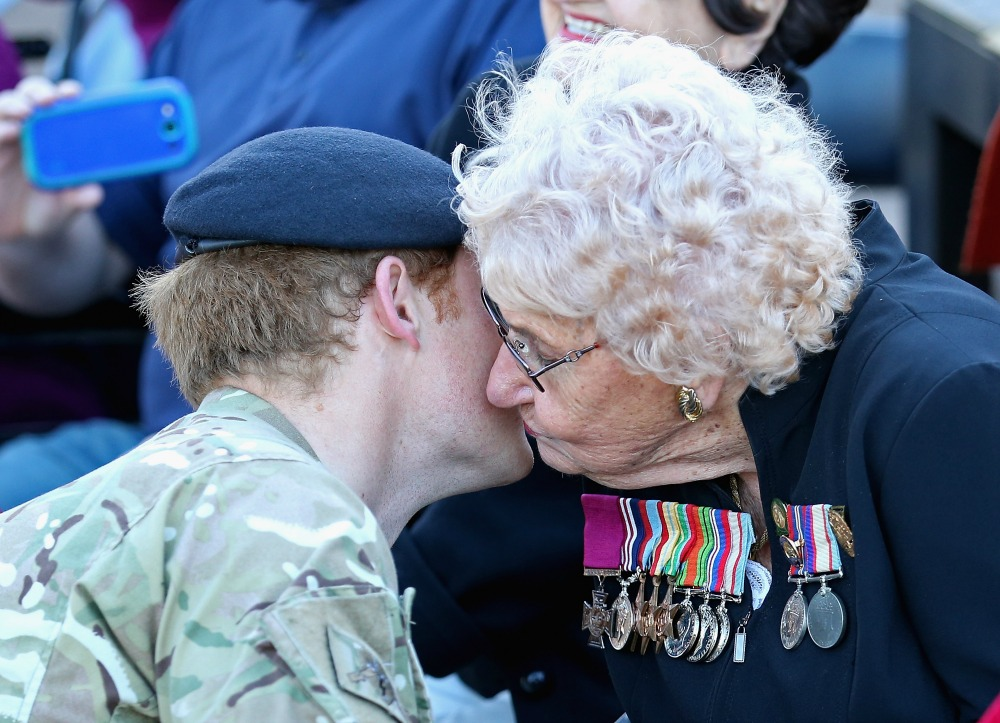 Prince Harry meets Daphne Dunne (wearing her husbands Victoria Cross) for the first time during a walkabout outside the Sydney Opera House on May 7, 2015 in Sydney, Australia. Source: Getty.