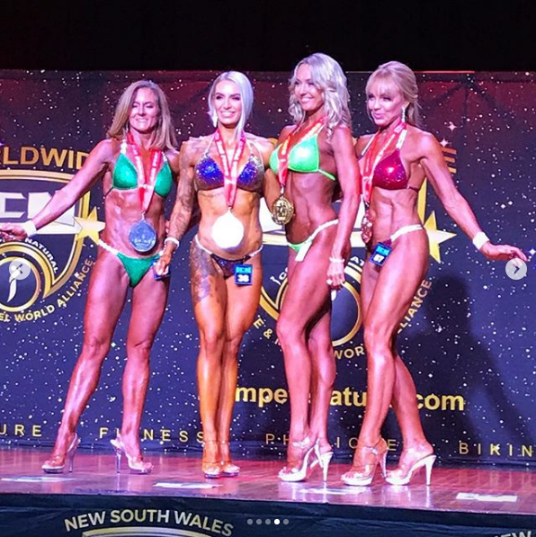 Natalie Joyce (left) poses alongside bodybuilding competition competitors in an event at the weekend.