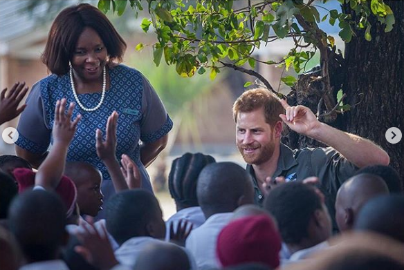 Prince Harry interacts with children during a trip to Botswana in 2017.