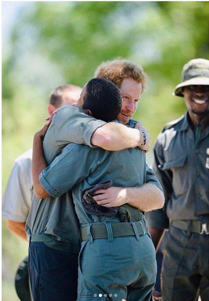Prince Harry hugs an environmental worker in Botswana.