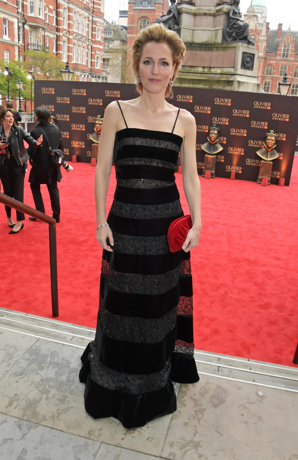 Gillian Anderson dazzled in a fitted floor-length black gown. Source: Getty