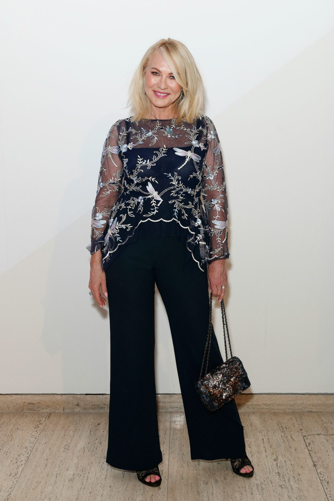 Kerri-Anne Kennerley jazzed up a pair of navy slacks for her latest outing.