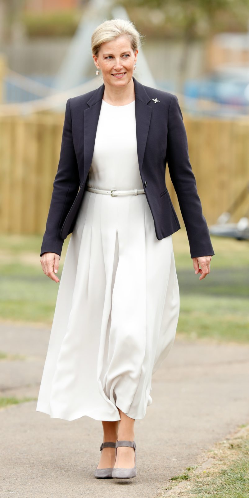 The countess chose a dark blazer to compliment the white dress. Source: Getty.