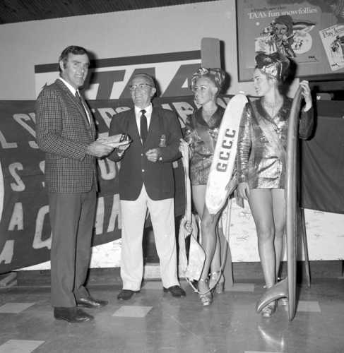 Mr McKinney, Mayor Ald. Small, with Surfers Paradise Meter Maids, Antonette Stengel and Angela Scott for the promotional launch of a Gold Coast produced surfing safety brochure, Gold Coast, Queensland, June 1972 . Photo: Bob Avery; City of Gold Coast Local Studies Library